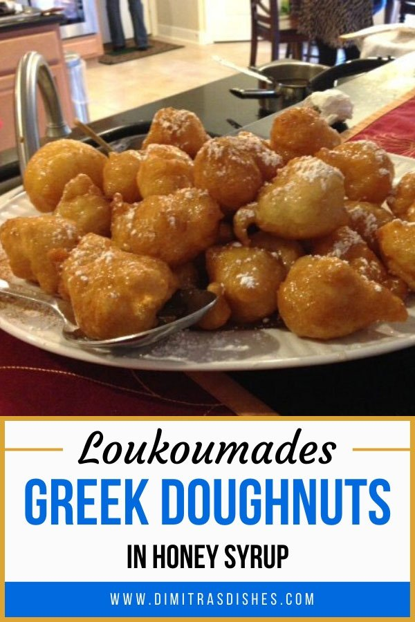 Greek-style donuts in honey syrup dusted with cinnamon and powdered sugar