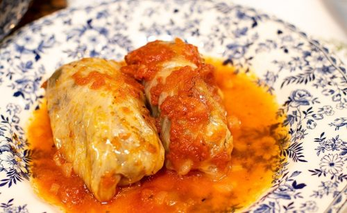Finished Greek cabbage rolls in tomato sauce in a plate